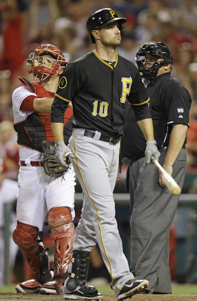 Pittsburgh Pirates' Jordy Mercer (10) walks to the dugout after striking out against Cincinnati Reds relief pitcher Aroldis Chapman in the ninth inning of a baseball game, Friday, July 11, 2014, in Cincinnati. Cincinnati won 6-5. (AP Photo/Al Behrman)