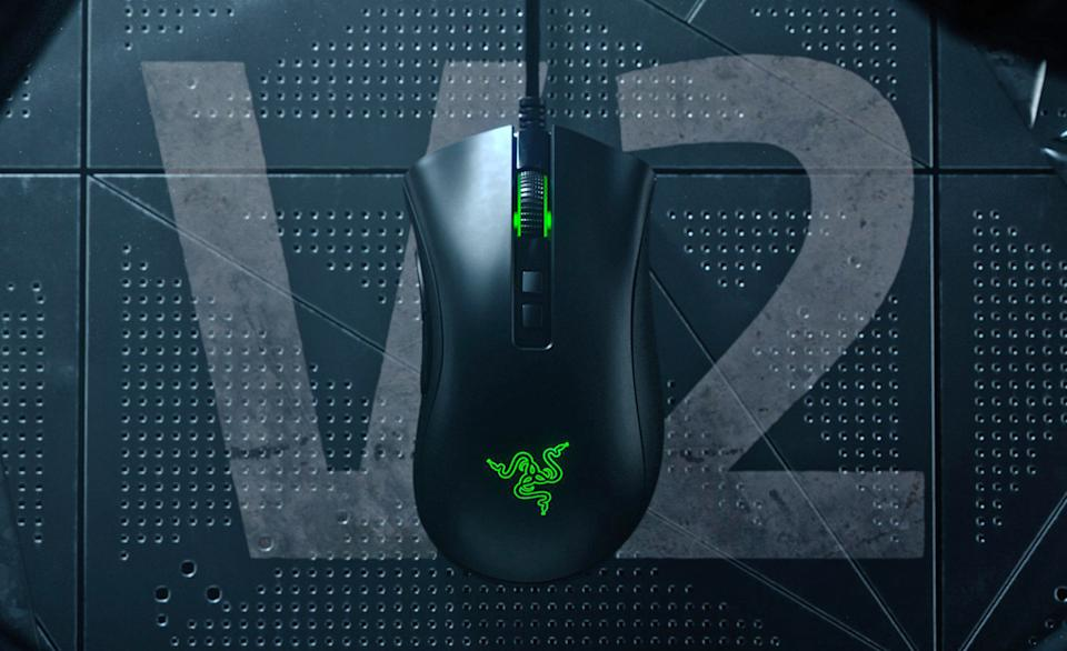 The Razer DeathAdder V2 displayed on top of a futuristic, but worn industrial surface with the term V2 overlayed on it.
