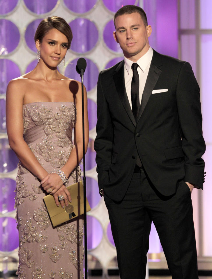 BEVERLY HILLS, CA - JANUARY 15: In this handout photo provided by NBC, actress Jessica Alba and Channing Tatum present an award onstage during the 69th Annual Golden Globe Awards at the Beverly Hilton International Ballroom on January 15, 2012 in Beverly Hills, California. (Photo by Paul Drinkwater/NBC via Getty Images)
