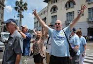Passengers of the first US-to-Cuba cruise ship to arrive in the island nation in decades, walk in the streets of Havana right after disembarking on May 2, 2016 (AFP Photo/Jorge Beltran)