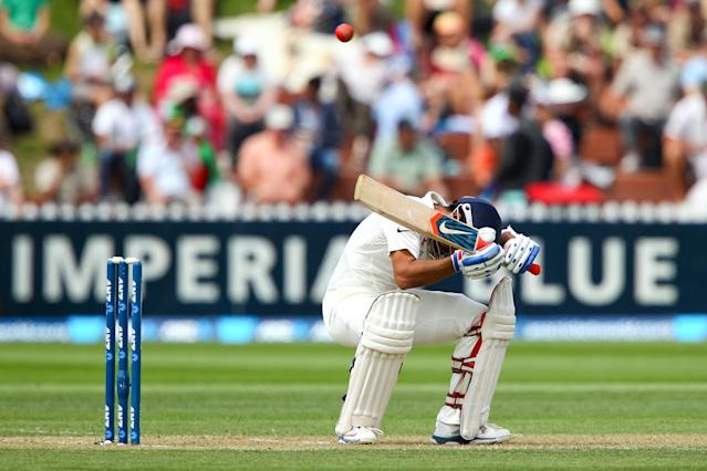 WELLINGTON, NEW ZEALAND - FEBRUARY 15: Ajinkya Rahane of India ducks under a bouncer during day two of the 2nd Test match between New Zealand and India on February 15, 2014 in Wellington, New Zealand. (Photo by Hagen Hopkins/Getty Images)