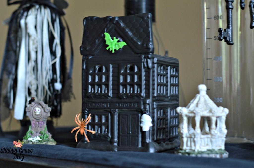 """<p>Your old Christmas village only needs a few sprays of paint and some store-bought creepers to lose all its cheer. <i>(Photo: <a href=""""http://shabbygraceblog.com/diy-spooky-halloween-village/"""">Shabby Grace</a>)</i></p>"""