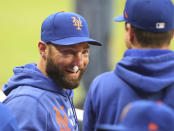 New York Mets' Kevin Pillar smiles in the dugout during the team's baseball game against the Atlanta Braves on Tuesday, May 18, 2021, in Atlanta. Pillar suffered multiple nasal fractures when he was hit on the face by a fastball from Braves reliever Jacob Webb on Monday. Pillar met Tuesday with a facial specialist in Atlanta to determine the next steps. He was placed on the 10-day injured list, but was at Truist Park to watch the second game of the series between the NL East rivals. (Curtis Compton/Atlanta Journal-Constitution via AP)