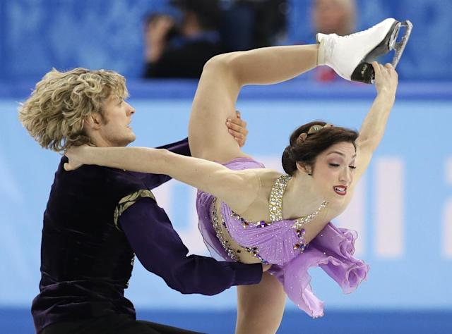 Meryl Davis and Charlie White of the United States compete in the ice dance free dance figure skating finals at the Iceberg Skating Palace during the 2014 Winter Olympics, Monday, Feb. 17, 2014, in Sochi, Russia
