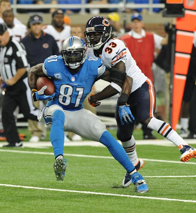 Detroit Lions wide receiver Calvin Johnson (81) makes a reception in front of Chicago Bears cornerback Charles Tillman (33) during the first quarter of an NFL football game at Ford Field in Detroit, Sunday, Sept. 29, 2013. (AP Photo/Jose Juarez)