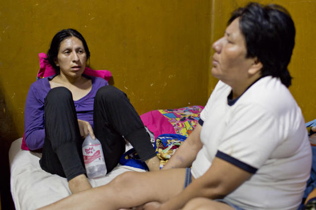 <p>Tamara sits on her bed with Evila after drinking electrolytes to help improve her worsening condition. (Photo: Danielle Villasana) </p>