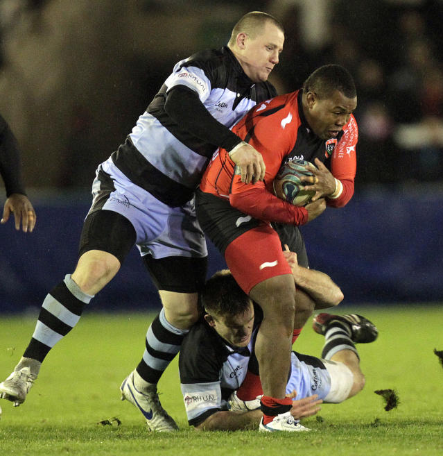 Newcastle Falcons' James Fitzpatrick (L) and Grant Shiells (ground) tackle Toulon's Stefan Armitage (R) during a pool 2, European Challenge Cup rugby union match at Kingston Park, Newcastle upon Tyne on December 8, 2011. AFP PHOTO/GRAHAM STUART (Photo credit should read GRAHAM STUART/AFP/Getty Images)