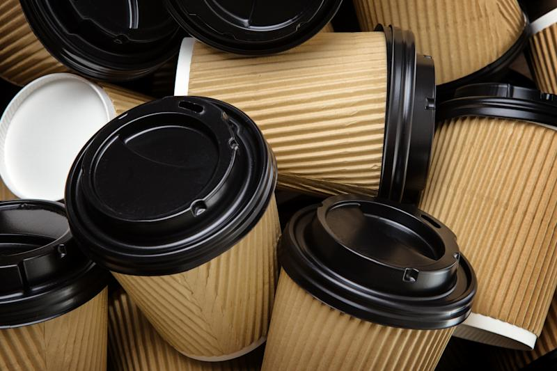 A pile of brown disposable coffee cups.