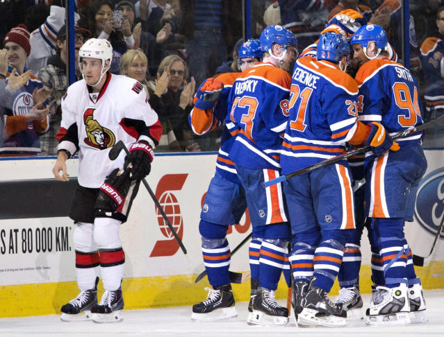 Ottawa Senators' Kyle Turris (7) skates past Edmonton Oilers' Nail Yakupov (64), Ales Hemsky (83), Andrew Ference (21) and Ryan Smyth (94) as they celebrate a goal during the first period of an NHL hockey game, Tuesday, March 4, 2014 in Edmonton, Alberta. (AP Photo/The Canadian Press, Jason Franson)