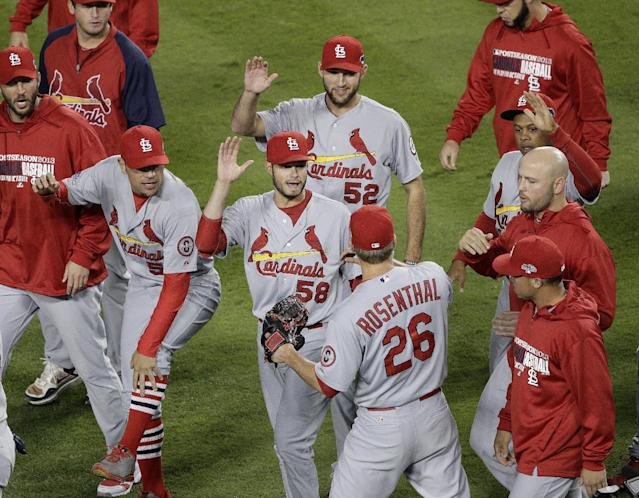 St. Louis Cardinals relief pitcher Trevor Rosenthal (26) is congratulated by teammates after Game 4 of the National League baseball championship series against the Los Angeles Dodgers Tuesday, Oct. 15, 2013, in Los Angeles. The Cardinals won 4-2 to take a 3-1 lead in the series. (AP Photo/Jae C. Hong)