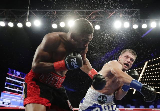 Ukraine's Sergiy Derevyanchenko, right, punches Daniel Jacobs during the 10th round of a IBF middleweight championship match Saturday, Oct. 27, 2018, in New York. Jacobs won the fight. (AP Photo/Frank Franklin II)