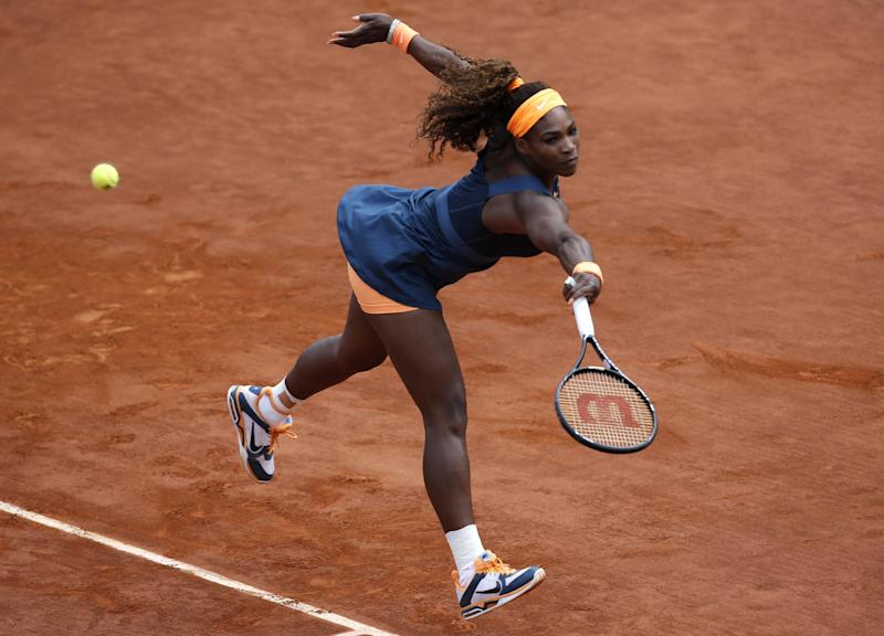 Serena Williams, of the U.S, returns the ball to Russia's Maria Sharapova during the Women's final match of the French Open tennis tournament at the Roland Garros stadium Saturday, June 8, 2013 in Paris. (AP Photo/Christophe Ena)