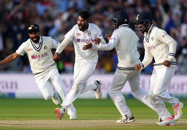 Mohammed Siraj, centre left, and India celebrate victory at Lord's