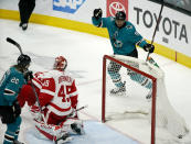 San Jose Sharks left wing Evander Kane (9) celebrates after scoring a goal past Detroit Red Wings goaltender Jonathan Bernier (45) during the third period of an NHL hockey game Monday, March 25, 2019, in San Jose, Calif. The Detroit Red Wings won 3-2. (AP Photo/Tony Avelar)