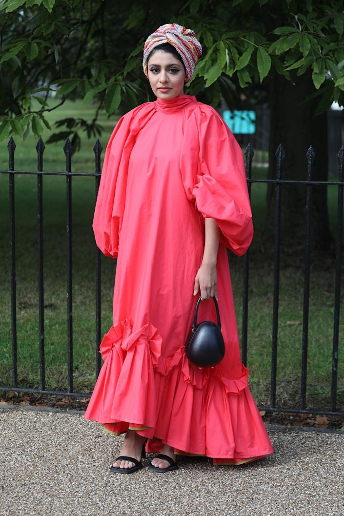 <p>This brilliant berry-hued dress is a statement all on its own. </p>
