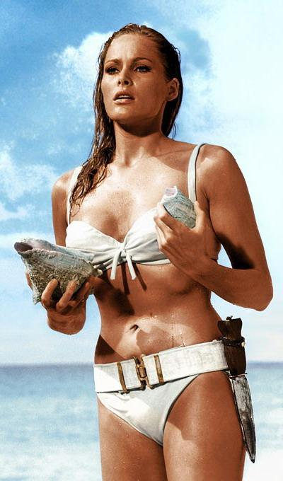 """<div class=""""caption-credit""""> Photo by: United Artists</div><div class=""""caption-title"""">Then</div>Ursula Andress, 76, was original Bond girl in 1962's """"Dr. No."""" As Honey Ryder she memorably emerged from the Caribbean sea with a knife strapped to her swimsuit. <br>"""