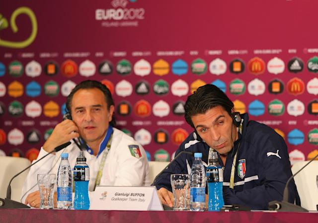 KIEV, UKRAINE - JUNE 30: In this handout image provided by UEFA, Coach Cesare Prandelli of Italy and Gianluigi Buffon (R) talk to the media during a UEFA EURO 2012 press conference at the Olympic Stadium on June 30, 2012 in Kiev, Ukraine. (Photo by Handout/UEFA via Getty Images)