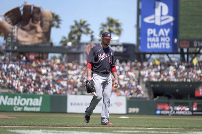 Washington Nationals pitcher Jon Lester (34) walks off the field after being taken out during the third inning against the San Francisco Giants in a baseball game Saturday, July 10, 2021, in San Francisco. (AP Photo/Tony Avelar)