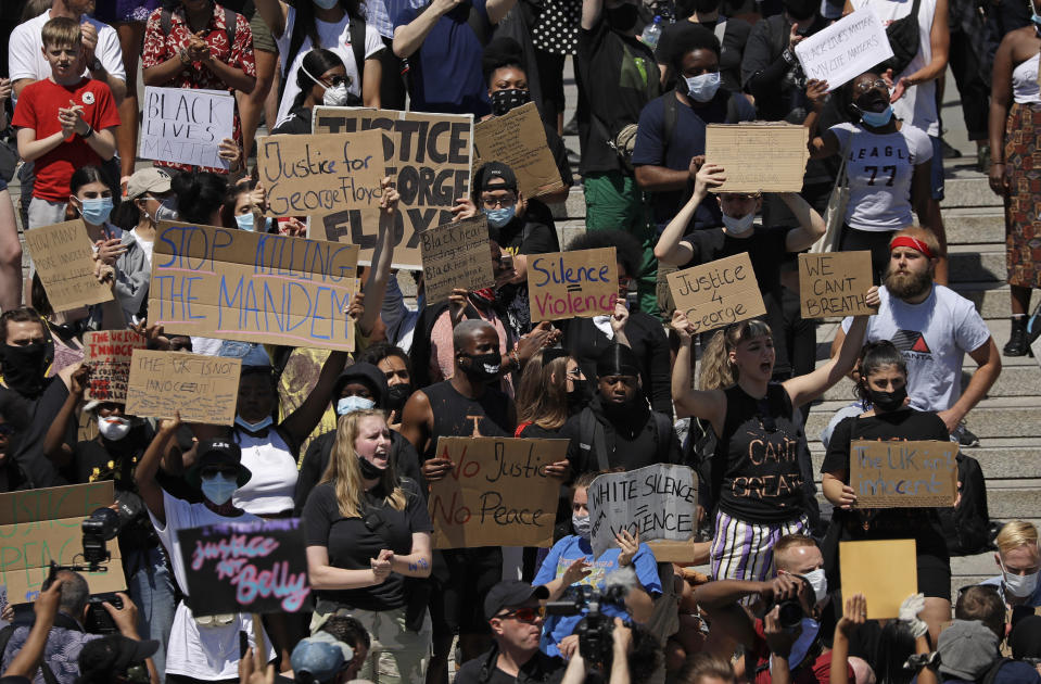 People gather in Trafalgar Square in central London on Sunday, May 31, 2020 to protest against the recent killing of George Floyd by police officers in Minneapolis that has led to protests across the US. (AP Photo/Matt Dunham)