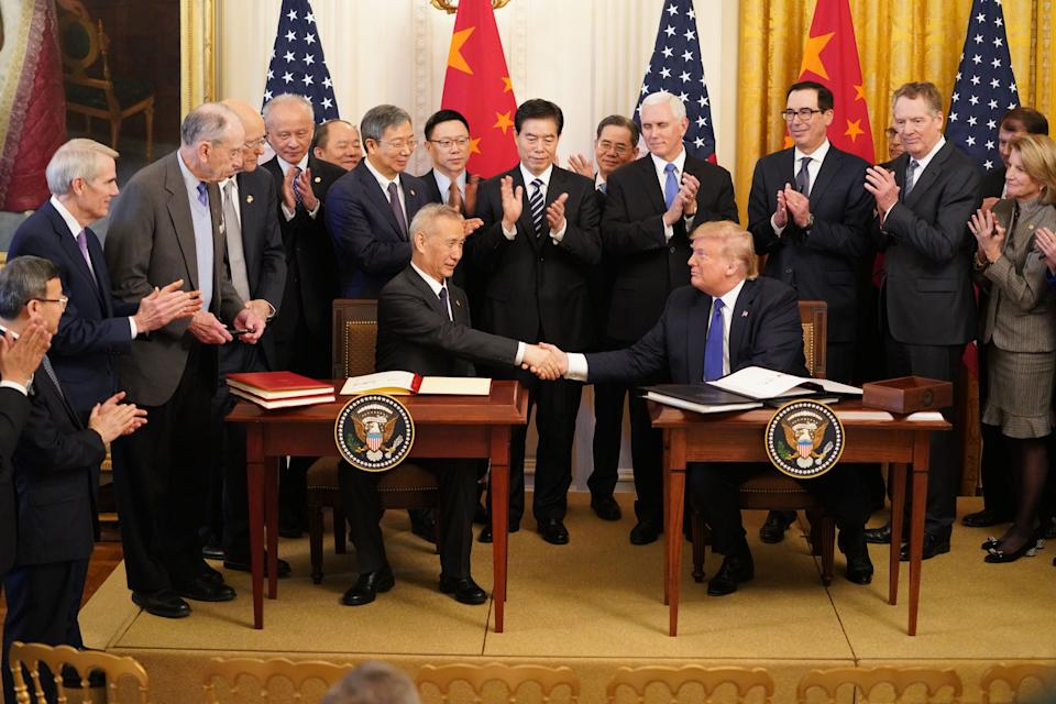 WASHINGTON D.C., Jan. 15, 2020 -- U.S. President Donald Trump and Chinese Vice Premier Liu He, who is also a member of the Political Bureau of the Communist Party of China Central Committee and chief of the Chinese side of the China-U.S. comprehensive economic dialogue, shake hands after signing the China-U.S. phase-one economic and trade agreement during a ceremony at the East Room of the White House in Washington D.C., the United States, Jan. 15, 2020.(Photo by Wang Ying/Xinhua via Getty) (Xinhua/Wang Ying via Getty Images)