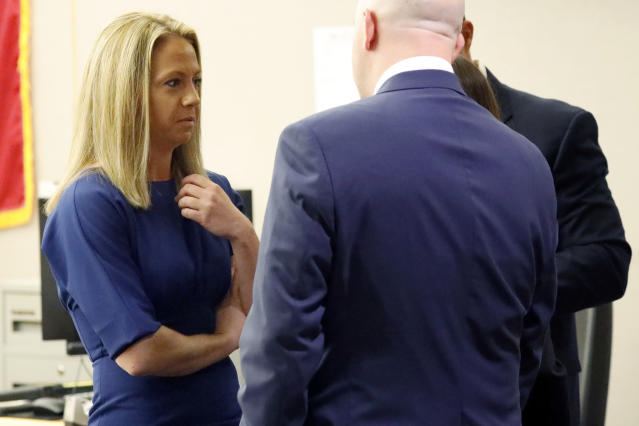 Former Dallas police Officer Amber Guyger speaks with her attorneys during a pretrial hearing in Judge Tammy Kemp's 204th District Court in Dallas, Monday, Sept. 23, 2019. Guyger is accused of shooting her black neighbor in his Dallas apartment. (Tom Fox/The Dallas Morning News via AP, Pool)