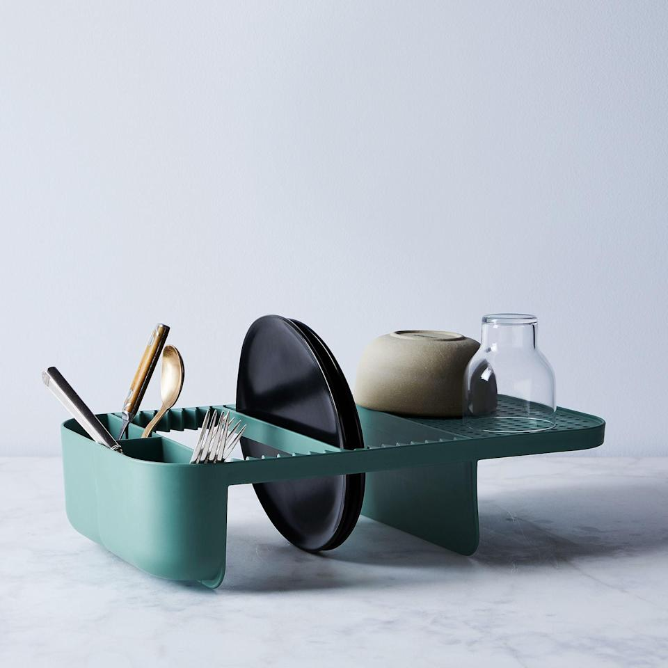 <p>If your friend doesn't have a ton of counter space but want a dish caddy, we found your solution. Behold, the <span>Rig-Tig Compact Modular Dish Rack</span> ($50). The smart design makes it so they can use the bottom as a wash bowl, and the interchangeable top can be used to their specific needs.</p>