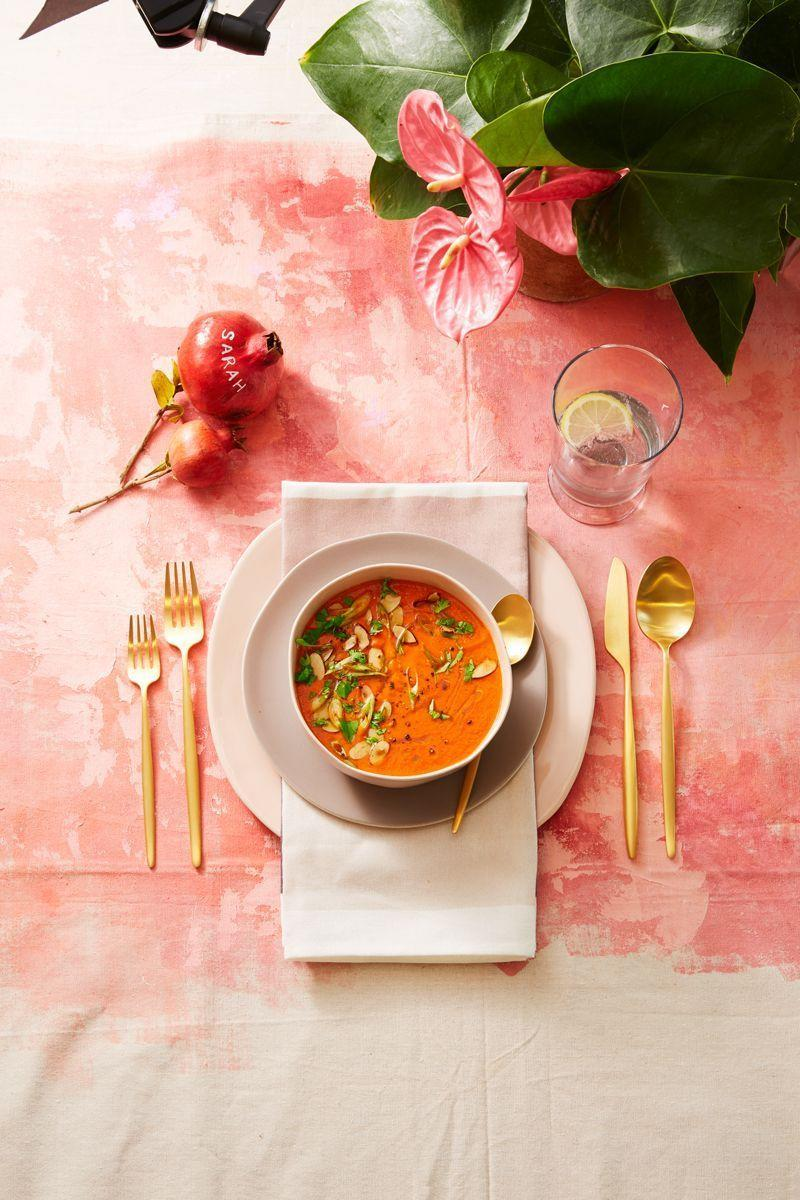 <p>Green and red aren't the only colors you're allowed to use on your Christmas table. A soft pink table cloth paired with gold cutlery feels warm and homey. </p>