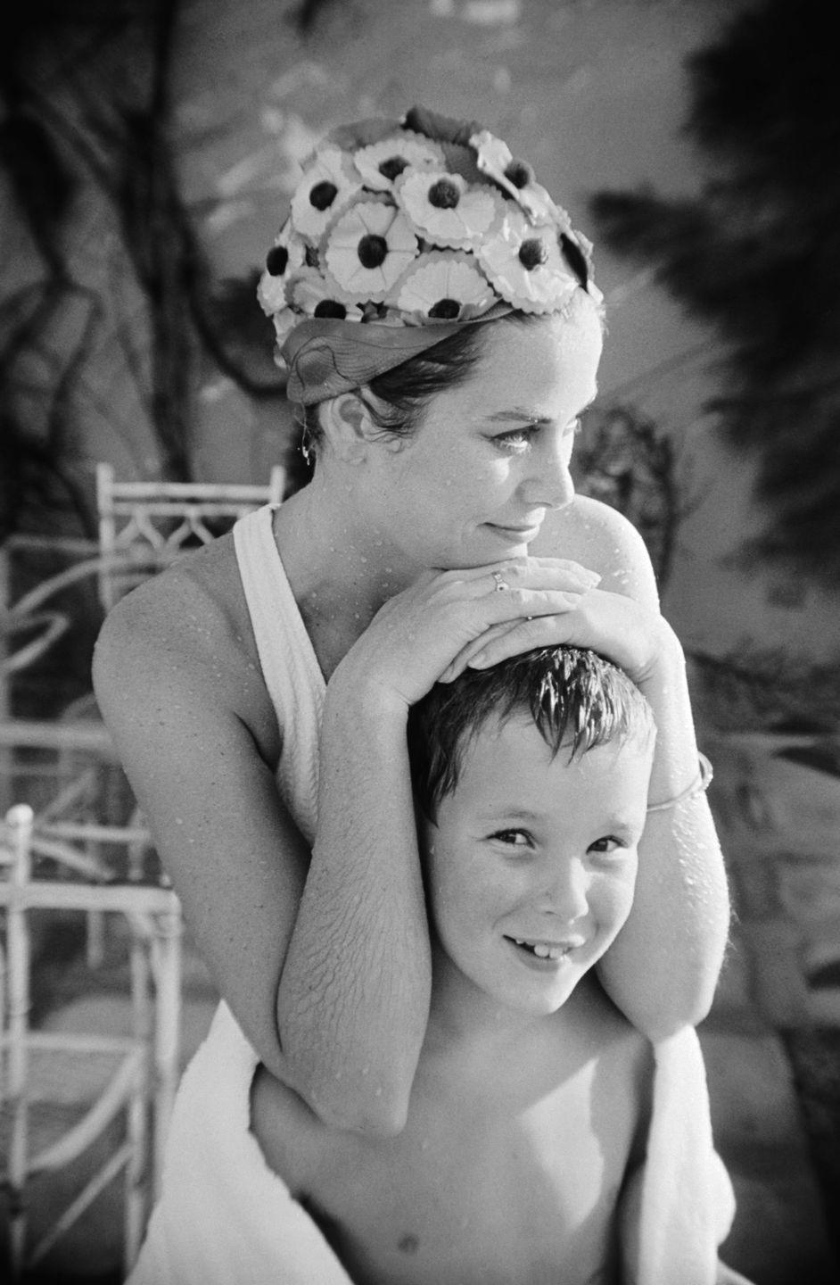 <p>While looking chic (per usual) in a floral swimming cap, Grace shares a tender moment with her son, Prince Albert II, on vacation in Montego Bay, Jamaica in 1967. </p>