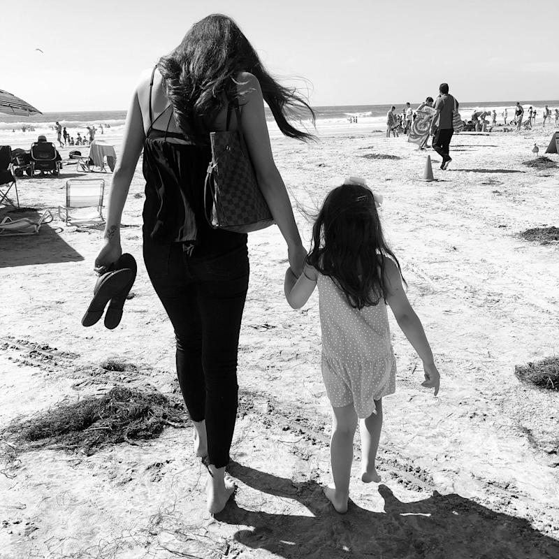 Caelin and Campbell walking on the beach