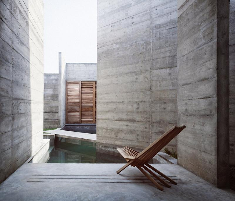 A narrow swimming pool allows the Zicatela House's inhabitants to swim through the concrete walls with ease.