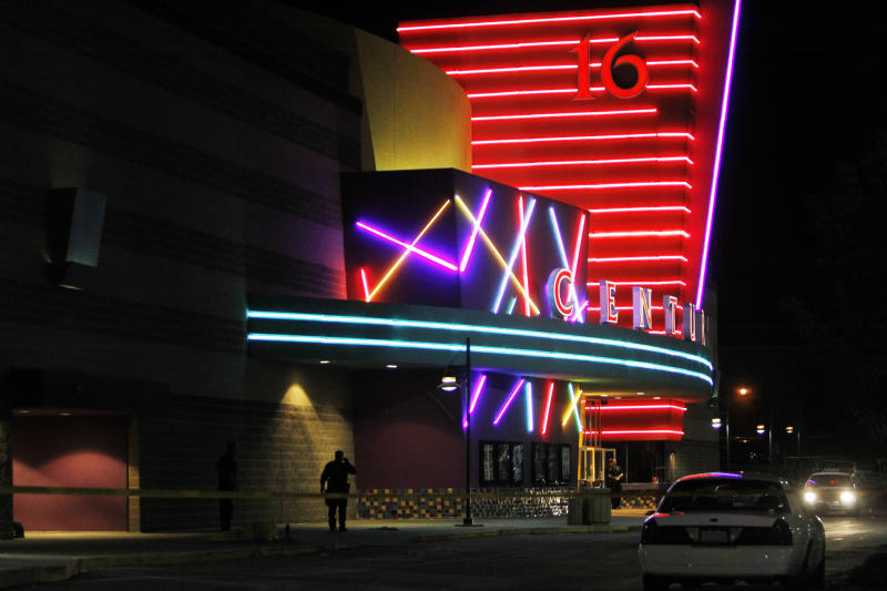 Police are pictured outside of a Century 16 movie theatre where as many as 14 people were killed and many injured at a shooting during the showing of a movie at the in Aurora, Colo., Friday, July 20, 2012. (AP Photo/Ed Andrieski)