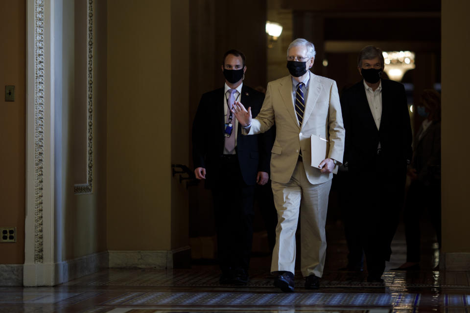 WASHINGTON, D.C., Aug. 10, 2020 -- U.S. Senate Majority Leader Mitch McConnell C walks pass the Ohio Clock Corridor on Capitol Hill in Washington, D.C., the United States, Aug. 10, 2020. Mitch McConnell on Tuesday urged the White House and congressional Democrats to restart negotiations on the next COVID-19 relief bill after talks broke down last week. (Photo by Ting Shen/Xinhua via Getty) (Xinhua/ via Getty Images)