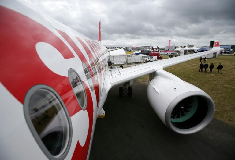 The Bombardier CS100 passenger jet is pictured on the opening day of the Farnborough Airshow, south west of London, on July 11, 2016