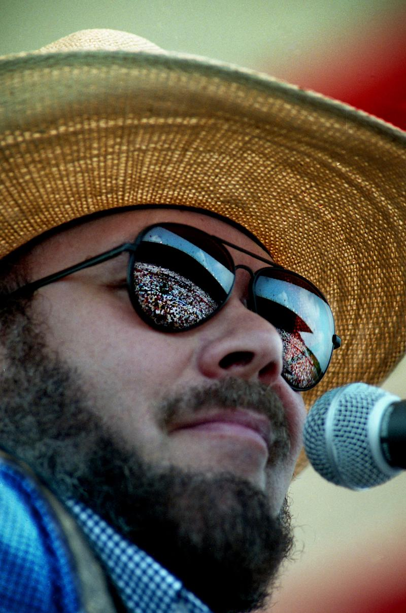 """With the huge crowd reflected in his sunglasses, Hank Williams Jr. performs his rambunctious """"Hog Wild"""" during the Curb Records show on the first full day of the 24th annual Fan Fair at the state fairgrounds June 6, 1995."""