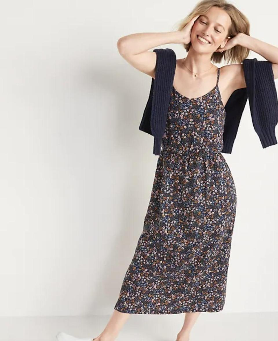 <p>You could easily wear a sweater over this <span>Old Navy Waist-Defined Floral Midi Cami Dress</span> ($35) to turn it into a skirt for fall. You can also style it with a cardigan or a trench coat; the possibilities are endless.</p>