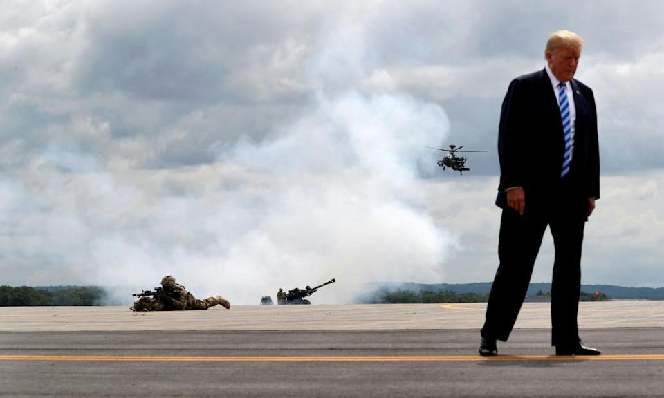 Trump observes a demonstration with the US army's 10th Mountain Division troops, an attack helicopter and artillery, as he visits Fort Drum, New York, in August 2018.
