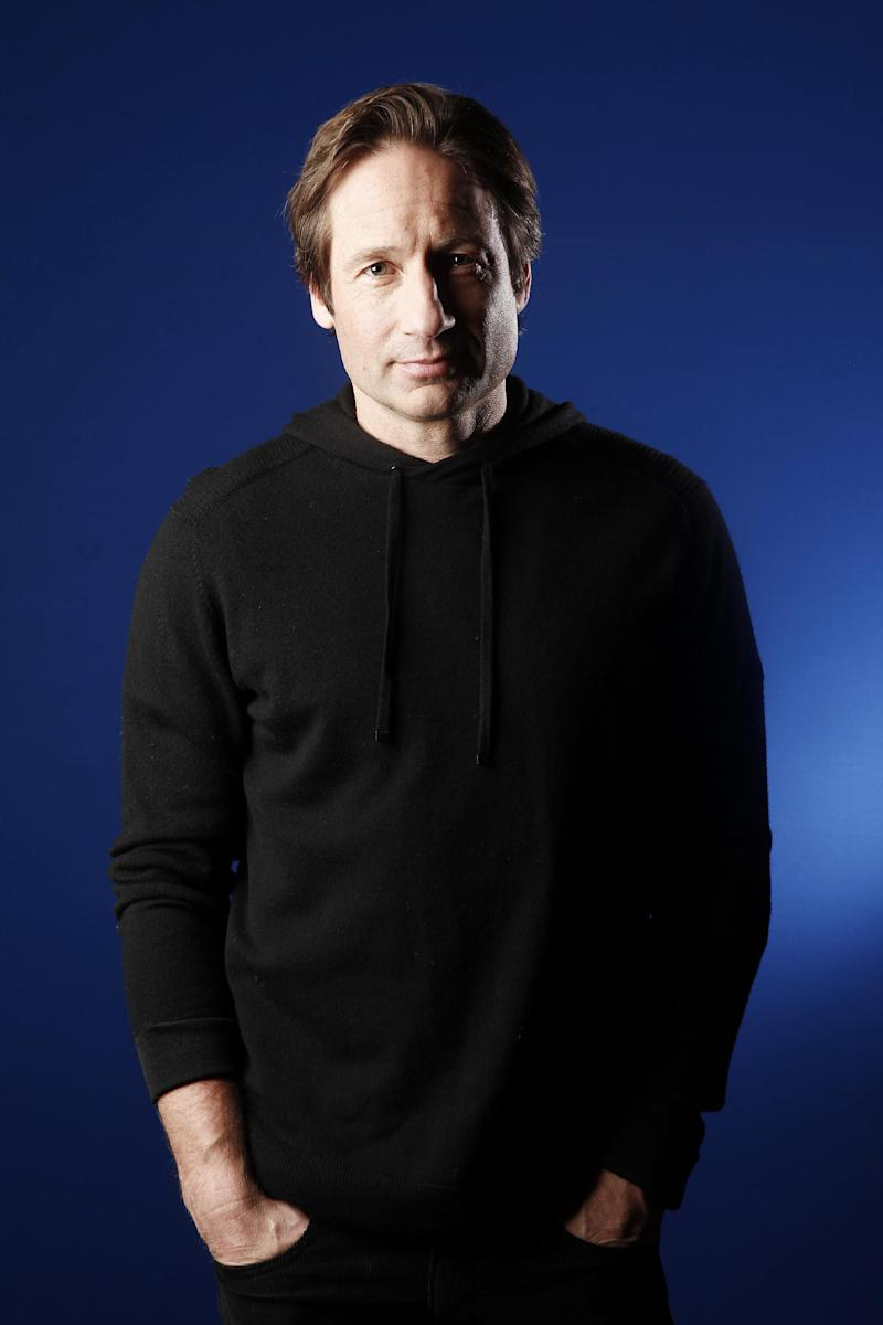 """FILE - In this Jan. 6, 2012 file photo, actor David Duchovny poses for a portrait in New York.  Duchovny stars in the Showtime comedy series """"Californication."""" (AP Photo/Carlo Allegri, file)"""