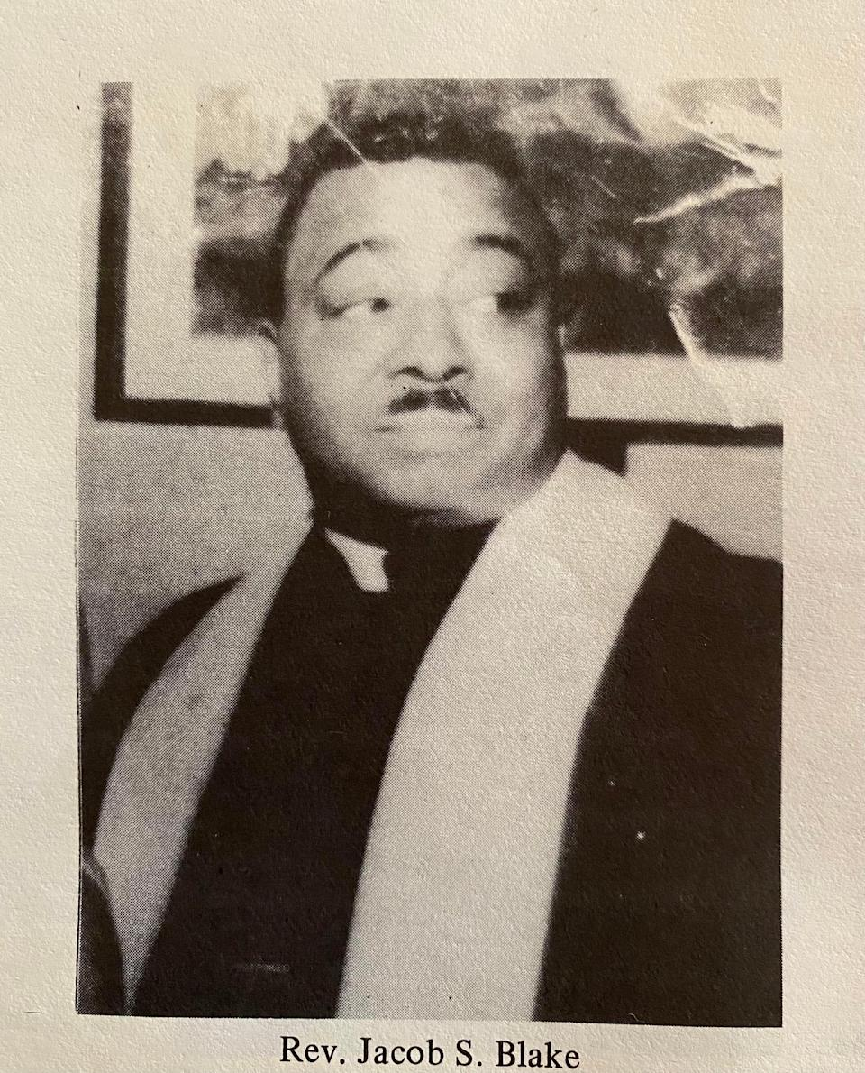 a reverend is seen in a black and white photo