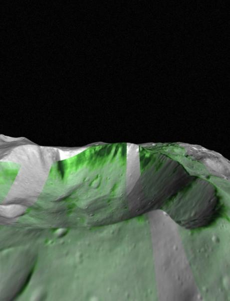 Olivine, a mineral commonly found in mantle rocks, has been detected on Vesta by NASA's Dawn spacecraft. Olivine outcrops within Bellicia crater are shown in deep green. The Infrared hyperspectral images are projected on Vesta combining imaging