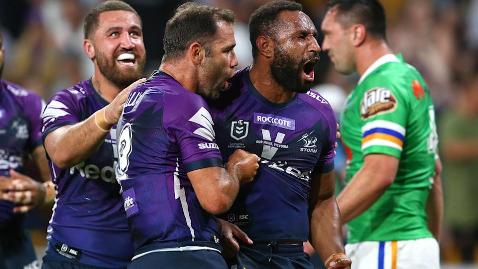 Justin Olam of the Storm is pictured celebrating a try in the NRL preliminary final against the Canberra Raiders.