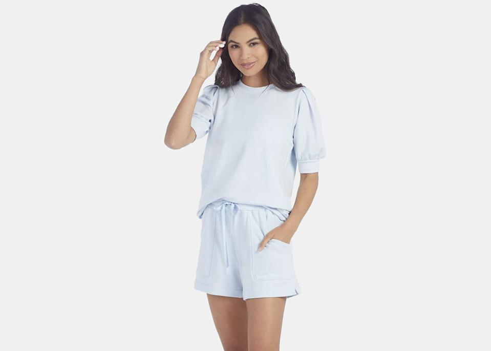 """Summersalt makes some of our favorite <a href=""""https://www.cntraveler.com/galleries/2015-07-28/the-best-pajamas-to-pack-for-any-trip-sleepwear?mbid=synd_yahoo_rss"""" rel=""""nofollow noopener"""" target=""""_blank"""" data-ylk=""""slk:cozy pajamas"""" class=""""link rapid-noclick-resp"""">cozy pajamas</a>, and this French terry set is just as appealing. The puff-sleeve top will stand out from the rest of the pullovers in your closet, and the shorts have pockets, which is always a plus in our book. Plus, the buttery-soft fabric is much lighter than the fleece lining of your favorite college sweatshirt, making it the ideal summer loungewear. $65, Summersalt (top). <a href=""""https://www.summersalt.com/collections/loungewear-matching-sets/products/the-softest-french-terry-puff-short-sleeve-powder-blue"""" rel=""""nofollow noopener"""" target=""""_blank"""" data-ylk=""""slk:Get it now!"""" class=""""link rapid-noclick-resp"""">Get it now!</a>"""