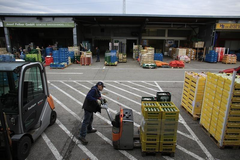 Abel moves a pallet as he works at a fruit and vegetable warehouse in Munich