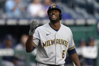 Milwaukee Brewers' Lorenzo Cain acknowledges the crowd's applause as he comes up to bat during the first inning of a baseball game against the Kansas City Royals Tuesday, May 18, 2021, in Kansas City, Mo. Cain is a former Royals player. (AP Photo/Charlie Riedel)