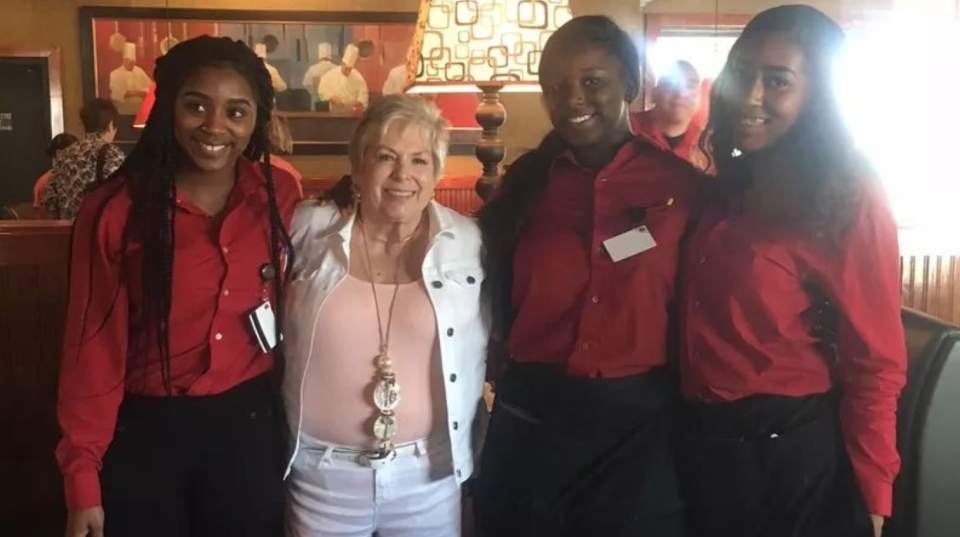 Barbara Foy with the friendly staffers at Ruby Tuesday. (Photo: Lauren Nave/WMBF News)