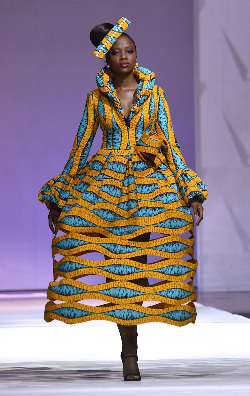 "A design by <a href=""http://dream.vlisco.com/patricia-waota/"" target=""_blank"">African designer Patricia Waota</a> made with Vlisco during the 170th anniversary of the manufacturer in Abijan, November 2016. (ISSOUF SANOGO via Getty Images)"