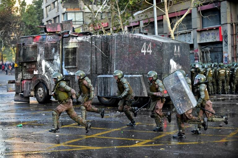 Chilean riot police charge at protesters in the capital Santiago, as the country marked the 40th day of continuous anti-government demonstrations