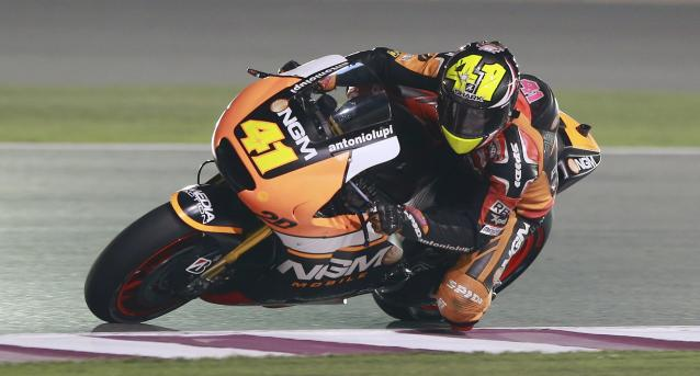 NGM Mobile Forward Racing MotoGP rider Aleix Espargaro of Spain rides his bike during a free practice session at the MotoGP World Championship at the Losail International circuit in Doha March 21, 2014. REUTERS/Mohammed Dabbous (QATAR - Tags: SPORT MOTORSPORT)