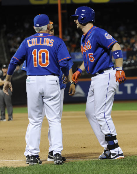 New York Mets' David Wright, right, talks with manager Terry Collins (10) and trainer Ray Ramirez after injuring his hamstring during the tenth inning of an interleague baseball game against the Kansas City Royals Friday, Aug. 2, 2013 at Citi Field in New York. (AP Photo/Bill Kostroun)
