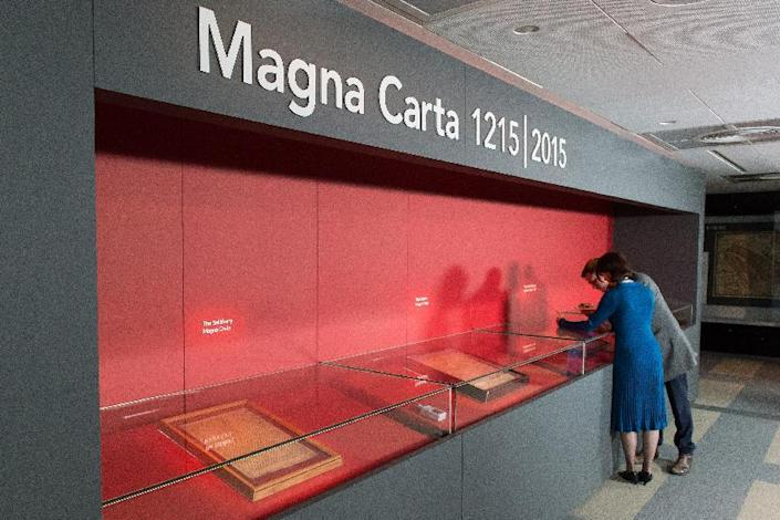 The four surviving original Magna Carta copies are pictured in display cases in the British Library in central London on February 2, 2015 (AFP Photo/Leon Neal)