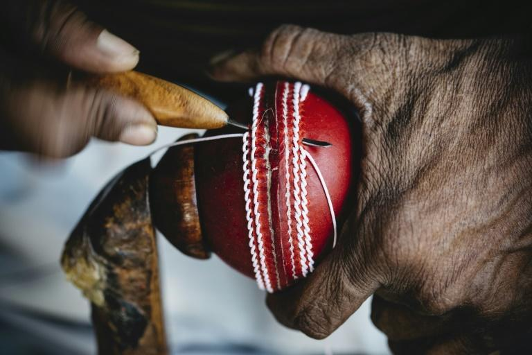 Handout picture released by Steve Waugh/Sams Marketing of a man stitching a cricket ball in Uttar Pradesh